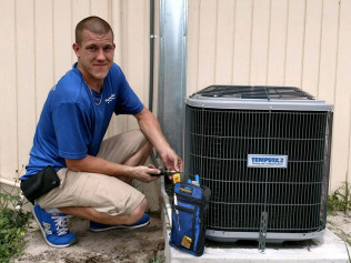 hvac contractor working on an AC unit in Naples, FL